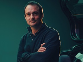 Fraser Dunn, chief engineer of special projects for Aston Martin Lagonda Ltd., pictured with the Valkyrie, a supercar, made for billionaires. Dunn is quitting Aston Martin to join Project Arrow, a Canadian effort to build a zero emissions car for families and create a Tesla north.